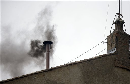 Black smoke emerges from the chimney on the roof of the Sistine Chapel on Wednesday, iindicating that the new pope has not been elected yet.