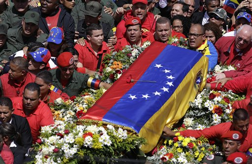 The flag-draped coffin containing the body of Venezuela's late The coffin of President Hugo Chavez is taken from the hospital where he died to a military academy where it will remain until his funeral in Caracas on Friday.