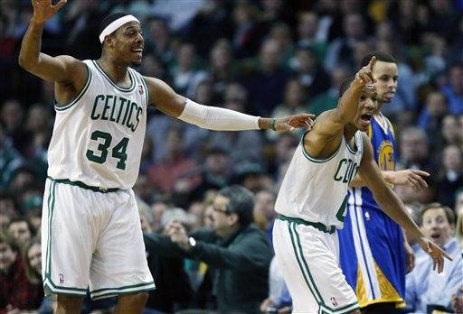 Boston Celtics' Paul Pierce (34) and teammate Avery Bradley (0) argue a call beside Golden State Warriors' Stephen Curry, right, during the second quarter of an NBA basketball game in Boston, Friday, March 1, 2013. (AP Photo/Michael Dwyer)