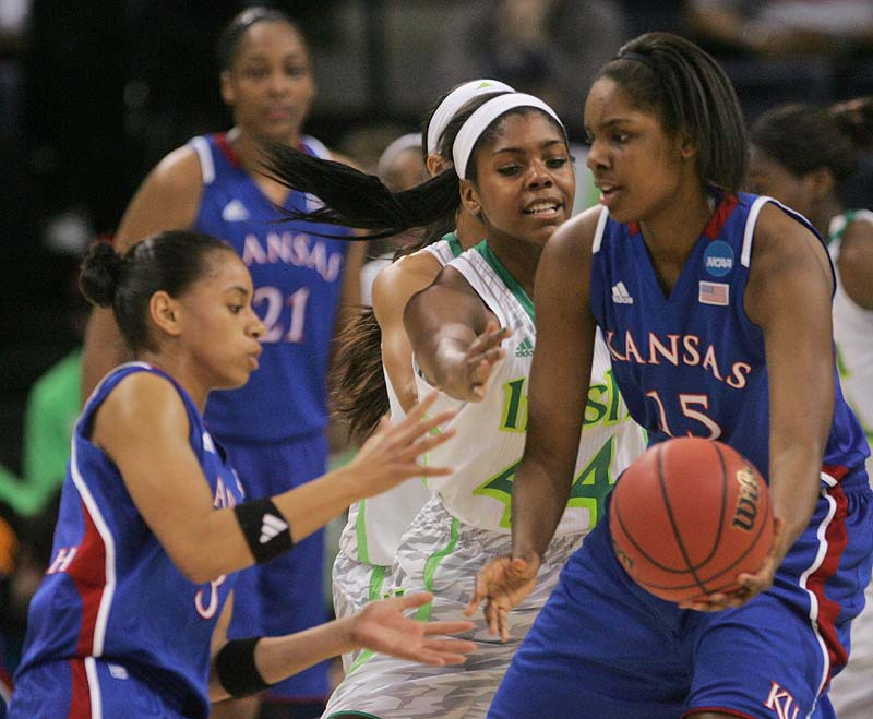 Kansas' Chelsea Gardner, 15, passes the ball to Angel Goodrich as Notre Dame's Ariel Braker pressures in Sunday's NCAA women's basketball regional semifinal at Norfolk, Va.