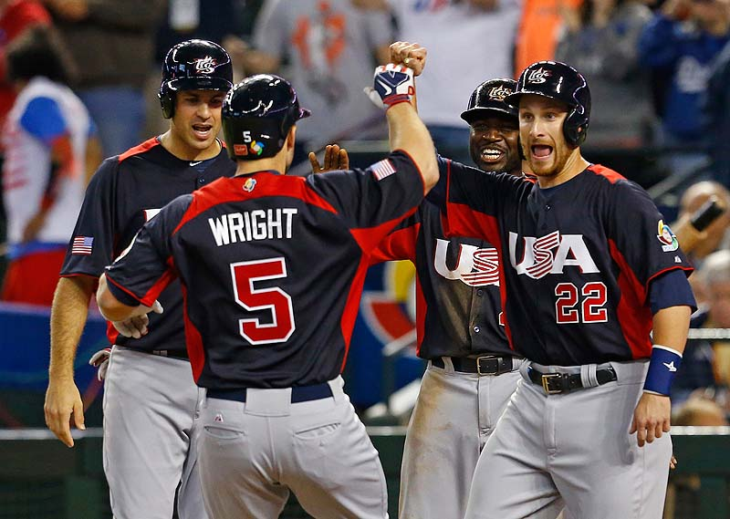 David Wright is greeted after hitting a grand slam in the fifth inning of a World Baseball Classic game against Italy Saturday. The U.S. won, 6-2.