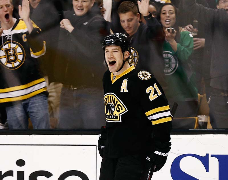 Fans celebrate with Boston Bruins' Andrew Ference after he scored against the Washington Capitals in the second period Saturday in Boston.