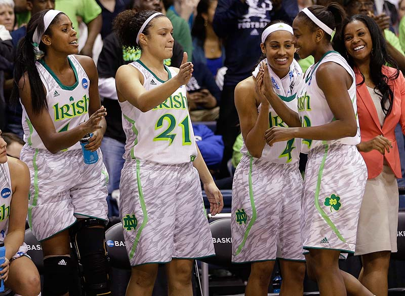 Notre Dame's Jewell Loyd, right is welcomed to the bench by teammates Skylar Diggins, second from right, Kayla McBride, 21, and Ariel Braker during the second half of Sunday's regional semifinal in the NCAA women's basketball tourney at Norfolk, Va. Notre Dame beat Kansas 93-63.