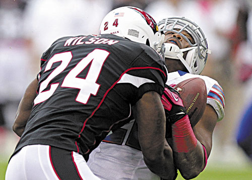 HITTING HARD: Adrian Wilson (24) levels Buffalo Bills running back Fred Jackson during the first half last season in Glendale, Ariz. With Wilson at strong safety, the New England Patriots have a new physical presence in the secondary. The newly-signed Wilson, who spent the last 12 seasons with the Cardinals, signed with the Patriots as a free agent.