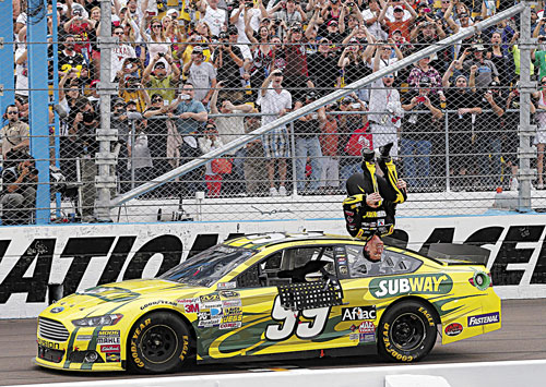 1st FLIP OF THE SEASON: Carl Edwards celebrates winning the NASCAR Sprint Cup Series race Sunday in Avondale, Ariz. It was Edwards' first win in 70 races.