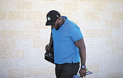 TAKING A BREAK: Boston's David Ortiz leaves the clubhouse after meeting with trainers Sunday in Fort Myers, Fla. The Red Sox have decided to shut down Ortiz for seven to 10 day with a sore heel.