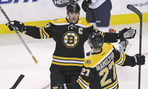 THAT'S A GOAL: Boston Bruins defenseman Zdeno Chara is congratulated by teammate Dougie Hamilton (27) after his goal against the Florida Panthers during the first period Thursday in Boston.