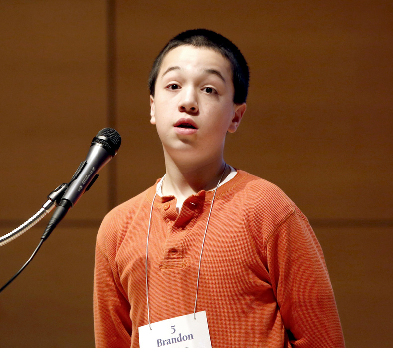 "Brandon Aponte, 12, representing Hancock County, reacts after being told he spelled the word ""crambo"" correctly to win the Maine State Spelling Bee at the Hannaford Lecture Hall at the USM Portland campus on Saturday."
