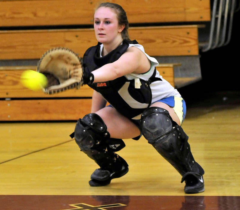 BACK AT IT: Nokomis Regional High School catcher Danielle George looks in a pitch at practice on Monday in Newport.