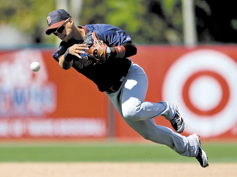 ON THE RUN: Boston's Jose Iglesias throws to first base after fielding a ground ball by Minnesota's Justin Morneau in the fourth inning Thursday in Fort Myers, Fla. Spring Training