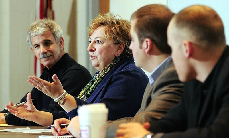 State Rep. Lori Fowle, D-Vassalboro, second from left, speaks during a legislative budget forum on Saturday at Augusta City Center. State Sen. Roger Katz, R-Augusta, left, and state Reps. Matt Pouliot and Corey Wilson, both R-Augusta, also took part.