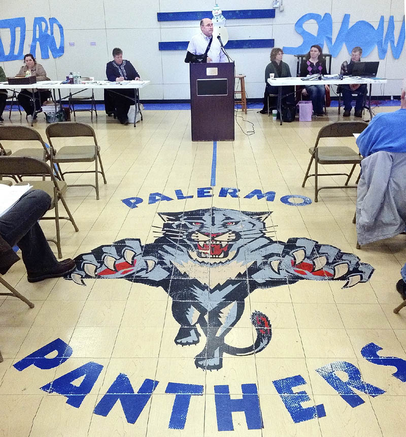 Dick Thompson serves as moderator during the annual town meeting on Saturday at the Palermo Consolidated School.