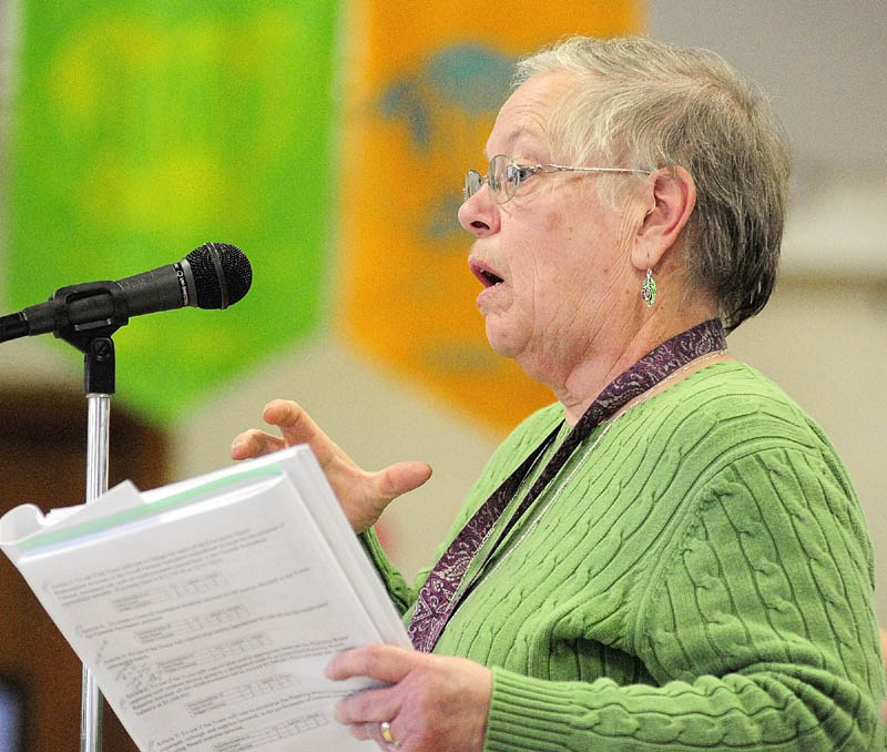 Jane Hubert participates in the debate during the Pittston town meeting on Saturday.