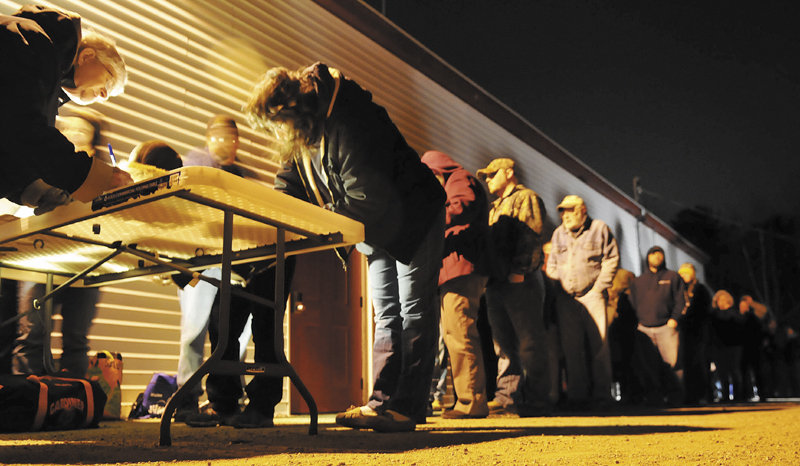 """Several hundred Pittston residents line up in the cold Thursday evening to sign petitions to recall the selectmen and town staff, following the termination of Ann Chadwick, 75, from town positions. Selectmen voted Wednesday to """"not reappoint"""" Chadwick. Chadwick's supporters pledged to present the petitions at the annual town meeting on March 18."""
