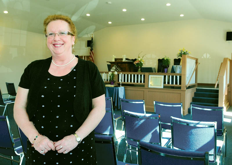 Augusta Spiritualist Church President Theresa Clifford stand in the group's new church on Saturday. It is located on Townsend Road, behind Barnes & Noble Booksellers.