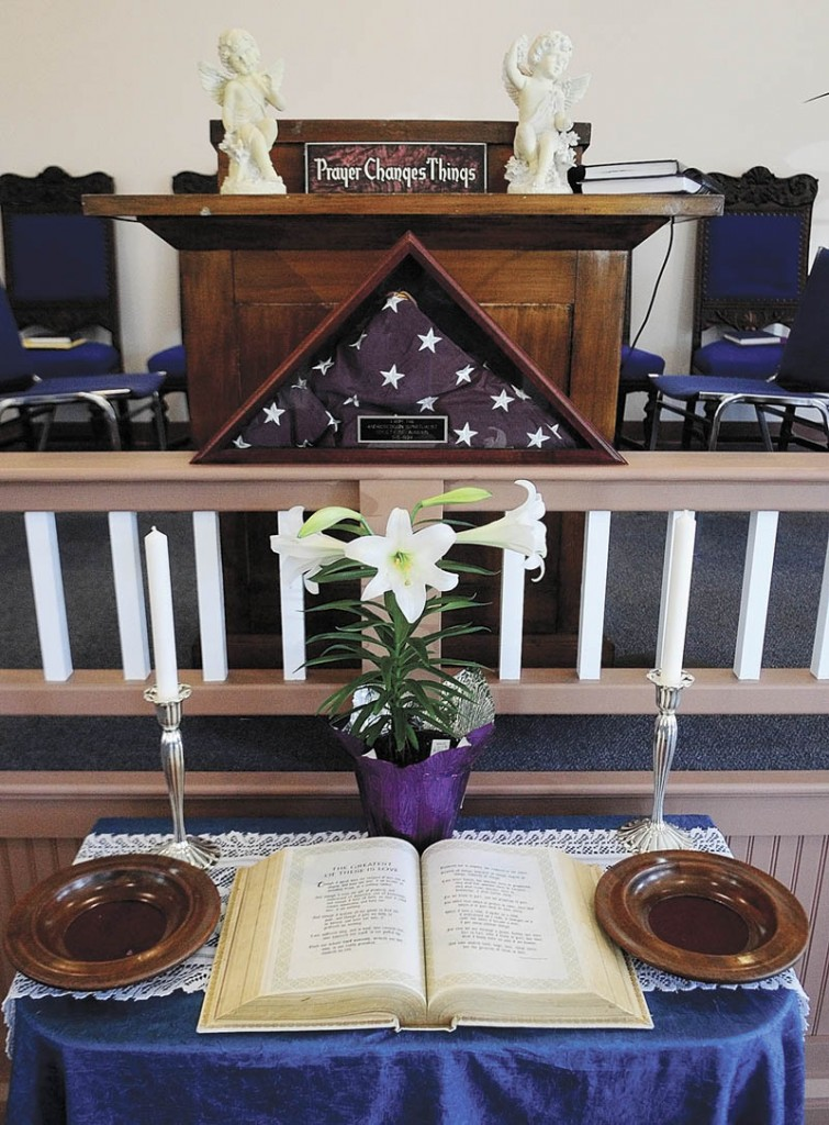 An open Bible is on the table on Saturday at the new location for the Augusta Spiritualist Church, on Townsend Road behind Barnes & Noble Booksellers.