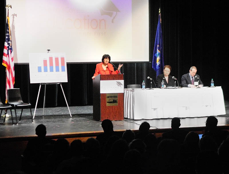Jeanne Allen, president of the Center for Education Reform, standing right, speaks during Governor's Conference on Education: Putting Students First on Friday at Cony High School in Augusta.