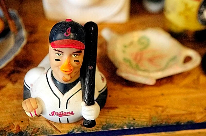 A Cleveland Indians baseball figurines is among the items at Bottles and More Redemption Shop in North Monmouth.