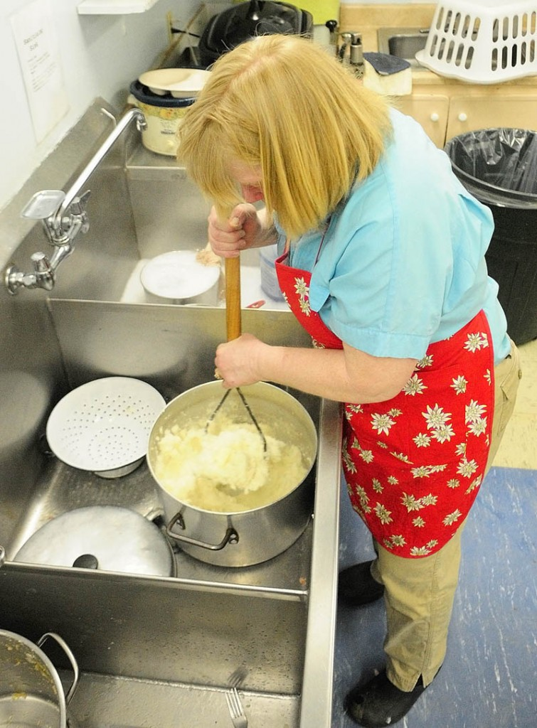 Ann Bako mashes potatoes on Saturday at the Palermo Consolidated School. Members of the Branch Mills Grange prepared lunch, turkey with all the trimmings and dessert, served during a break in the annual town meeting. Grange members said that two 32-pound turkeys were donated by Tobey's Market.