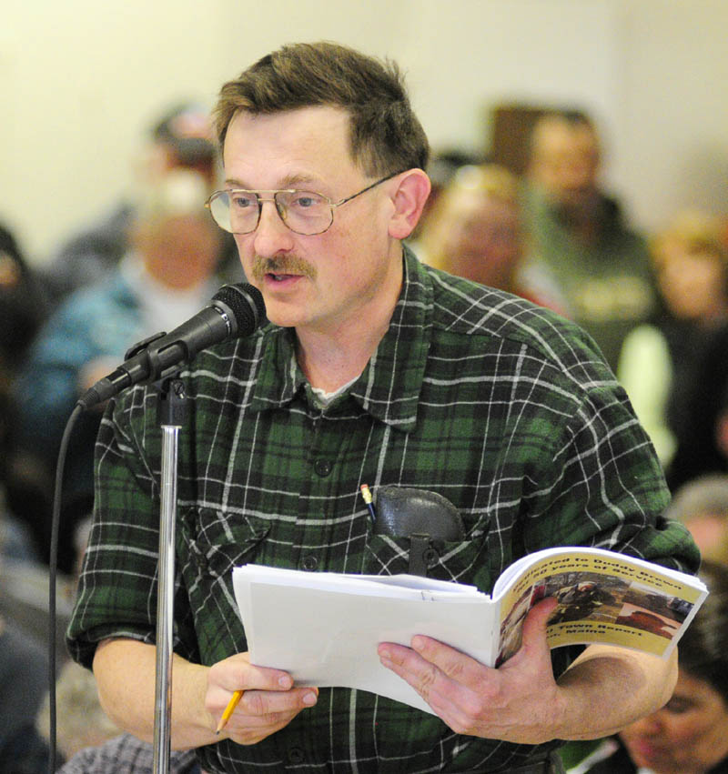 Tim Lawrence participates in the debate during the Pittston town meeting on Saturday.