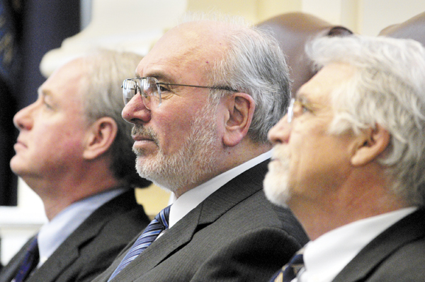 James Page, chancellor of the University of Maine System, left, John Fitzsimmons, president of the Maine Community College System and William Brennan, president of Maine Maritime Academy, sit in front of the House chamber before giving their State of Education addresses on Thursday at the State House in Augusta.