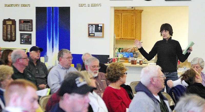 Jean Jessen speaks during debate on one of the articles at the West Gardiner Town Meeting on Saturday.