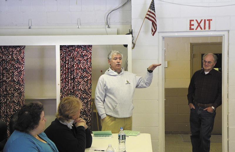 State Sen. Tom Saviello, R-Wilton, addresses residents before the start of the Rome Town Meeting on Saturday. Saviello, who represents District 18, addressed current issues and took questions from residents while waiting for a quorum to arrive.