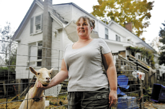 Marcina Johnston is raising goats with her family in the back yard of their Gardiner home in defiance of a city ordinance. Johnston hopes to change the ordinance to permit small farm animals within the urban compact.