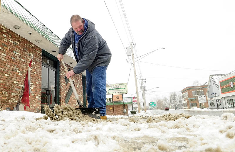 "Don Berube shovels snow from a late winter storm in front of Lisa's Restaurant on Bangor Street in Augusta Tuesday. ""It's an endless chore that's got to get done,"" Berube said. He'll probably be out shoveling that sidewalk on Bangor Street five or ten more times, he said."