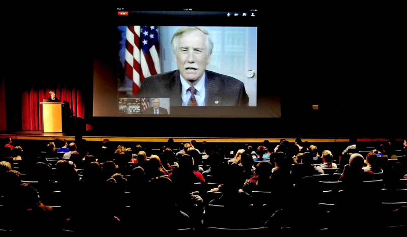 Sen. Angus King addresses Lawrence High School students via a Skype system at the Fairfield school on Wednesday. Principal Pam Swett is at the podium at left.