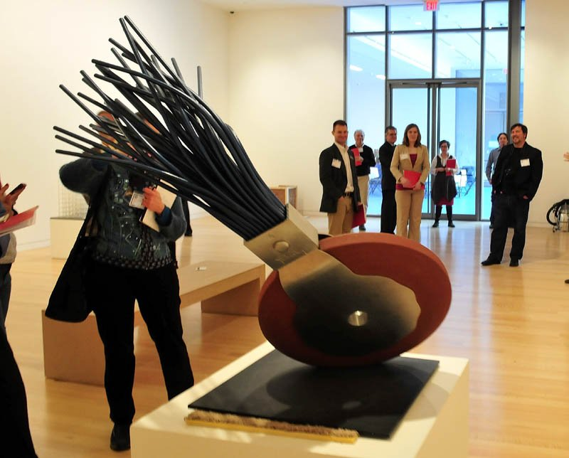 People view a sculpture of a typewriter eraser in the new Alfond-Lunder Family Pavilion, inside the Colby College Museum of Art in Waterville, on Monday.