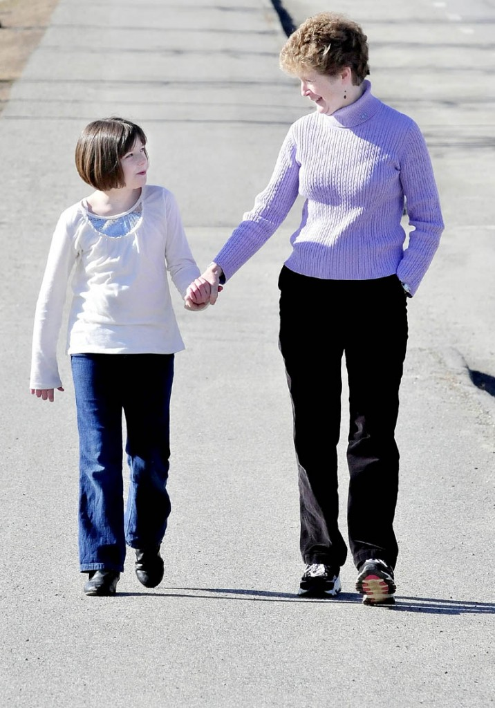 Destinee Pearl, of Augusta, left, and Valerie King, of Palermo, seen walking in Waterville recently.