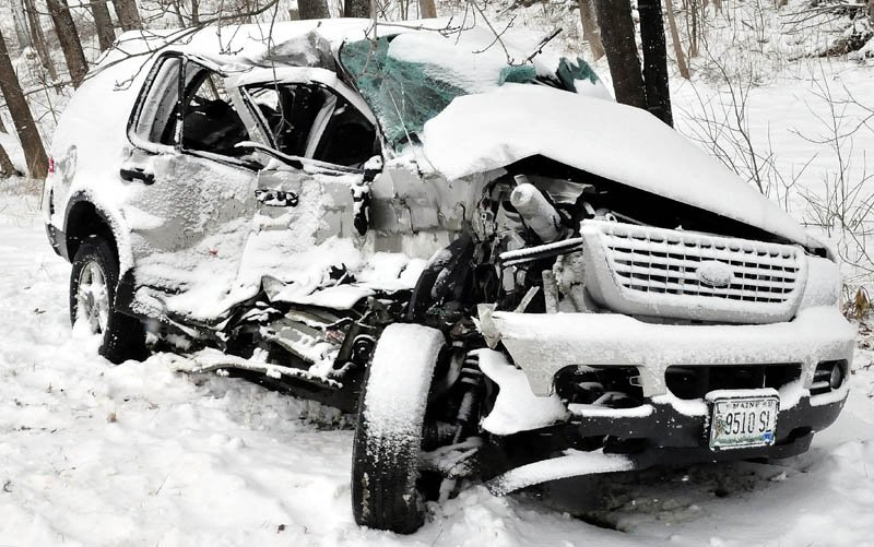 The vehicle sustained serious damage following a collision with a construction truck on snow-covered Route 139 in Benton on Tuesday.