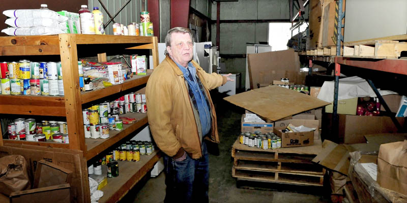 Pastor Ken Stevens talks about his expansion plans inside the current North East Dream Center in Winslow on Tuesday. Stevens' organization collects food which is distributed to area pantries.