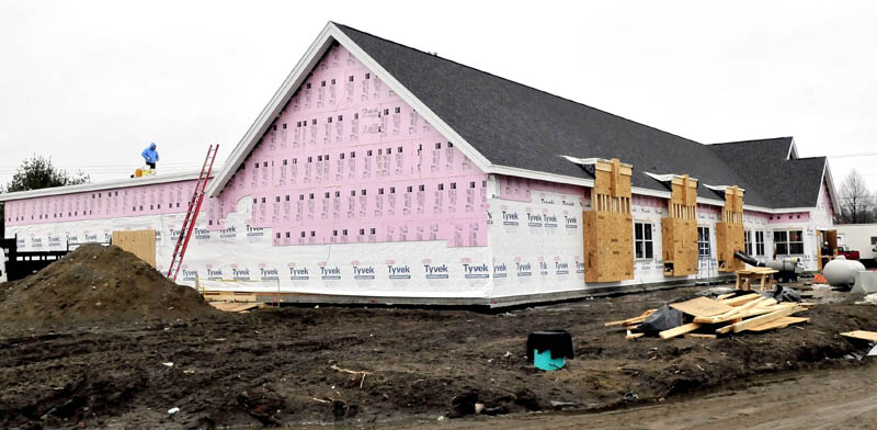 Workers continue to make progress building the new Waterville police department building on Tuesday. The building is expected to be completed this June.