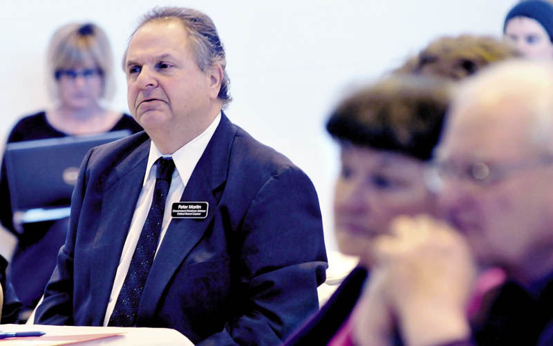 Peter Martin, government relations advisor for Oxford Resort Casino, listens to speakers during the Conference on Problem Gambling Awareness on Thursday.