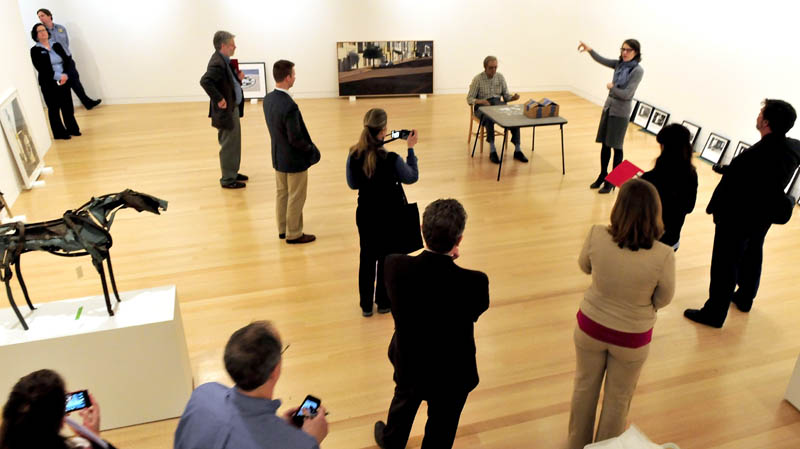 Colby College Museum of Art curator Sharon Corwin, gesturing at right, leads a media tour through the new Alfond-Lunder Family Pavilion building at the Waterville campus on Monday.