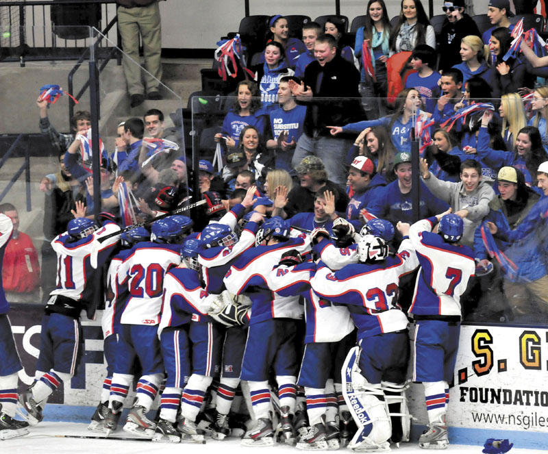 Messalonskee fans and players celebrate after the Eagles beat John Bapst 7-2 in the Eastern B regional final Tuesday at Alfond Arena.