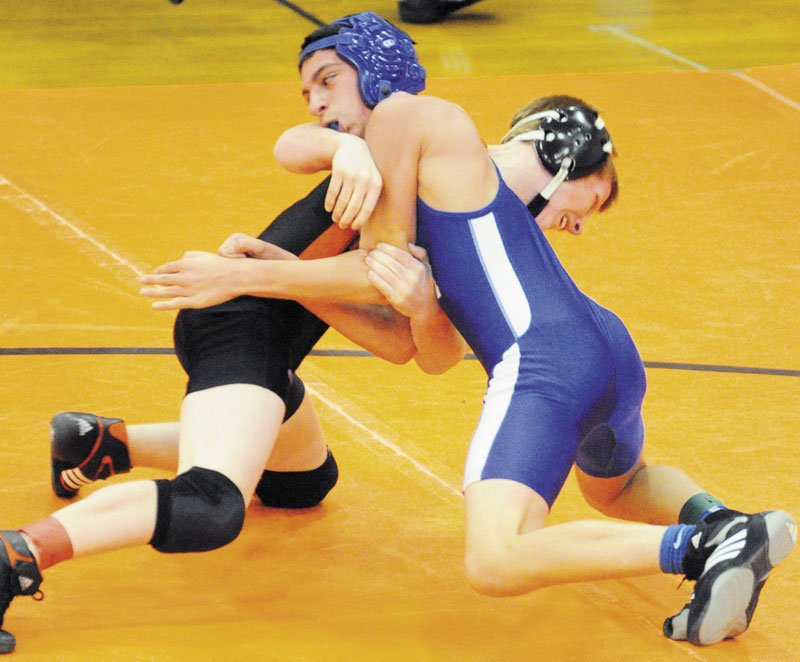 MAKING AN IMPACT: Gardiner's Peter Del Gallo, back in black, and Erskine Academy's Justin Studholme grapple during the 113-pound championship match of the Tiger Invitational earlier this years. Del Gallo, a freshman, won the 106-pound title at the New England championships on Saturday.
