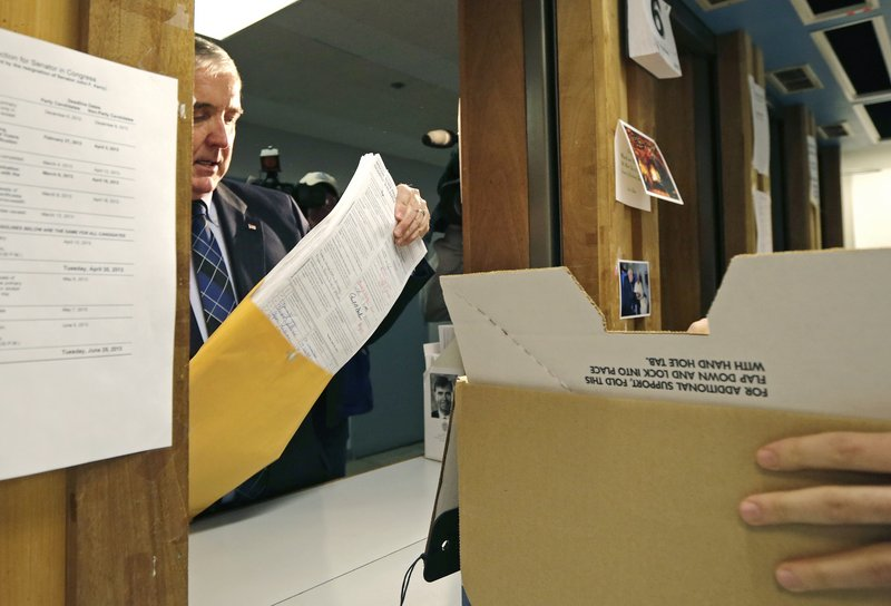 Republican U.S. Senate candidate Michael Sullivan drops off signatures at the secretary of state's office, allowing him a spot on the primary ballot for the special election to fill the seat formerly held by John Kerry, in Boston, Wednesday, March 6, 2013. (AP Photo/Charles Krupa)