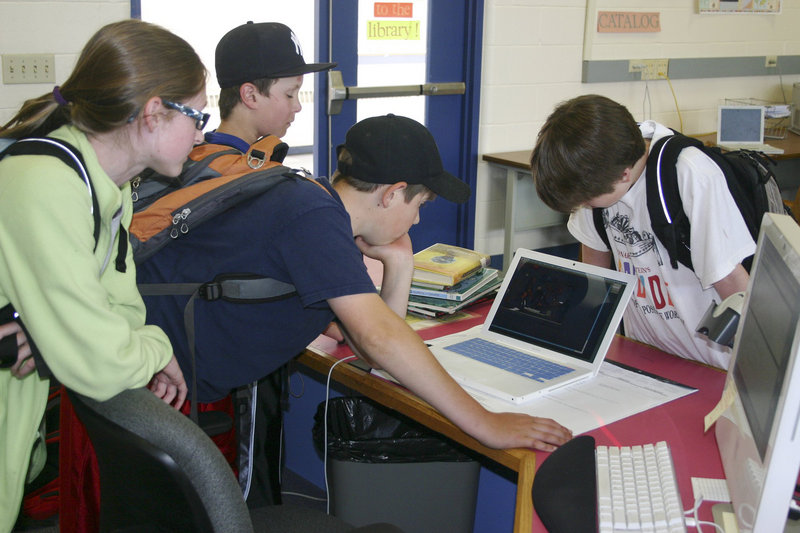 Students at Cape Elizabeth Middle School use a school laptop in June 2011. A request for archival documents about the state's school laptop program revealed a problem with how Jeff Mao, the state official in charge of the program, was backing up his emails. The Department of Education says it has taken steps to correct the issue.