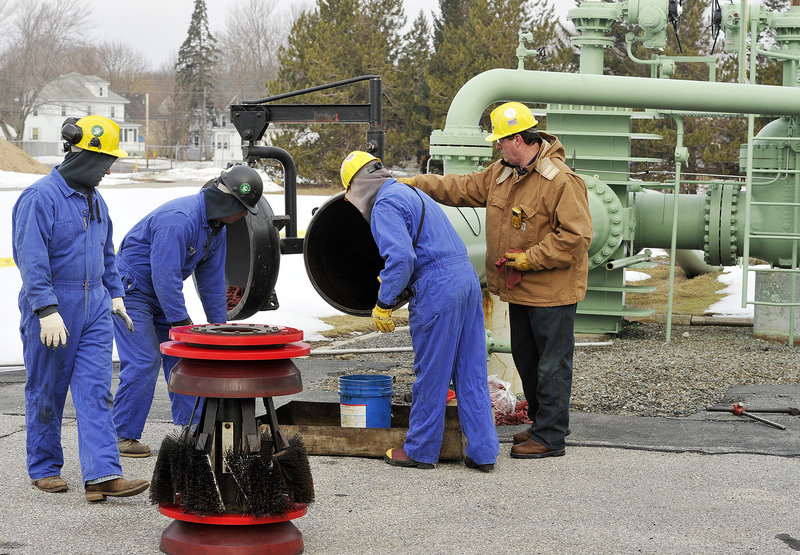 "Pipeline workers prepare the scraper-launching trap in mid-March before their brush ""pig"" device was to begin its two-and-a-half-day trip to Montreal to clean the 24-inch-diameter pipe."