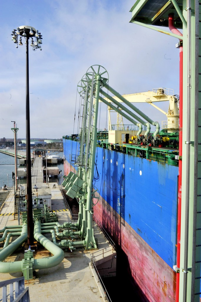 Unloading arms remove oil for storage from the oil tanker HS Electra at Portland Pipe Line's pier facility in South Portland.