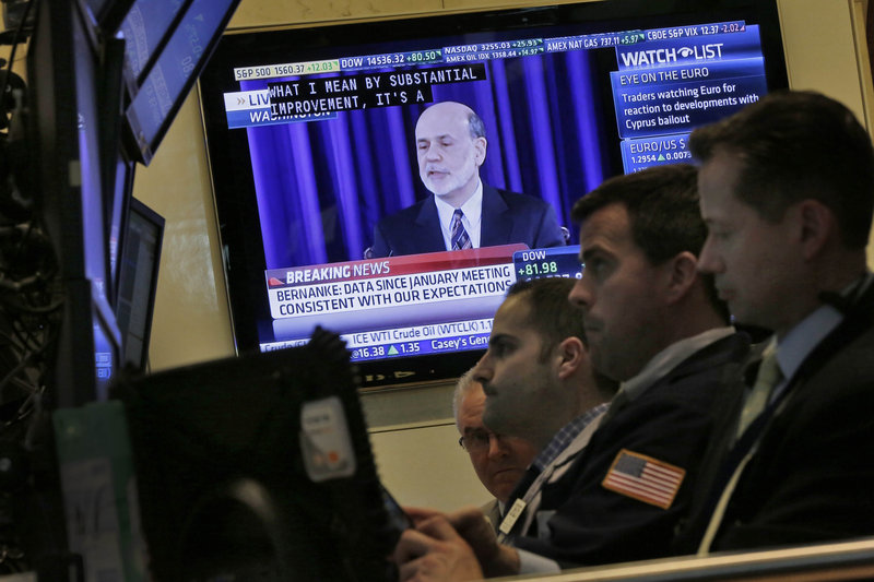 A television at the New York Stock Exchange shows Federal Reserve Chairman Ben Bernanke's news conference Wednesday after a two-day meeting of the Fed.