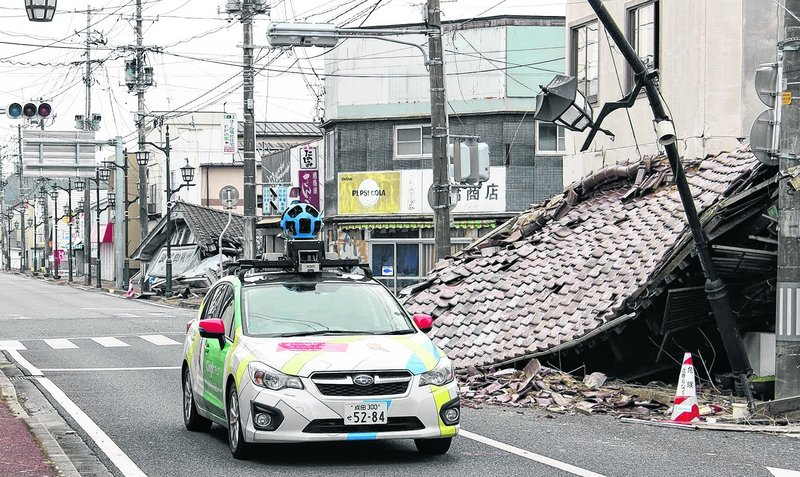 Google's camera-equipped car moves through Namie, Japan, sill uninhabitable because of radioactive contamination from the Fukushima Dai-ichi nuclear power plant two years.