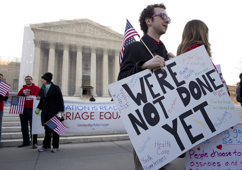 Supporters of gay marriage rally in front of the Supreme Court. Justices suggested in this week's hearings that they might allow same-sex marriage to resume in California.