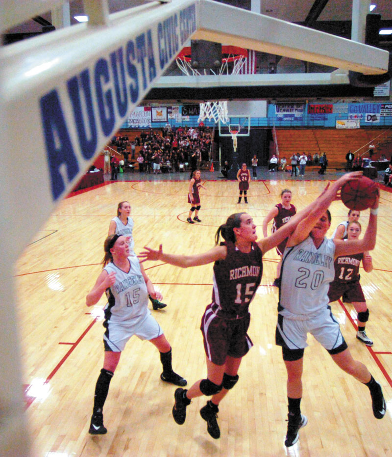 Jamie Plummer, center, and the Richmond girls basketball team faces Washburn in the Class D state title game Saturday at the Bangor Auditorium.