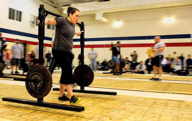 Nicole Turbide, of Bangor, competes in the yoke walk during the 2013 Central Maine Strongman contest on Saturday at the Augusta armory.