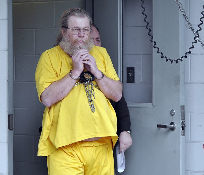 Gary Irving, convicted rapist, leaves the Cumberland County Courthouse to get on the bus to head back to jail after his extradition hearing Monday morning.