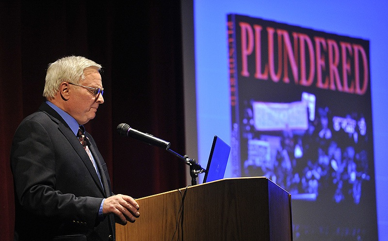 """Michael Coffman discusses topics from his latest book, """"Plundered: How Progressive Ideology is Destroying America,"""" during a program at Lake Region High School on Saturday."""
